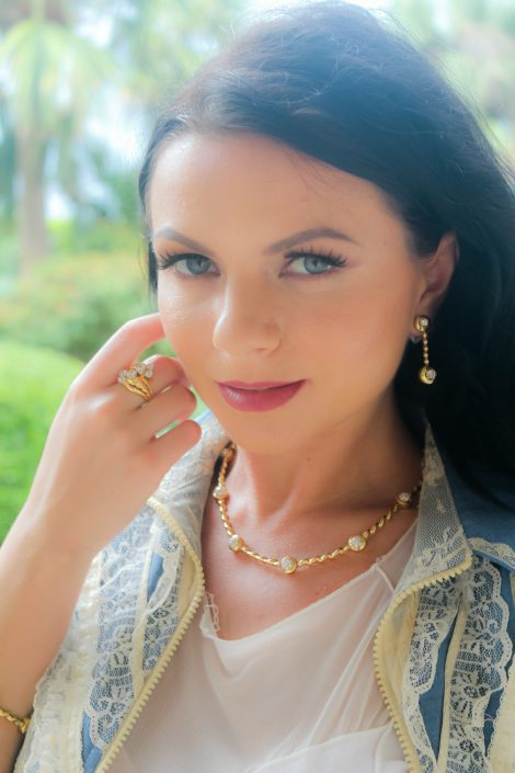 Flowing Lines Diamond Necklace in 18K Yellow Gold with matching Earrings.