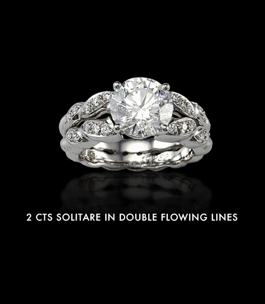 2 carats solitaire in double flowing lines