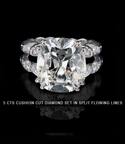 5 carats ring with cushion cut diamond set in split flowing lines