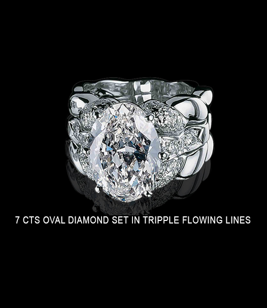 7 carats ring with oval diamond set in triple flowing lines
