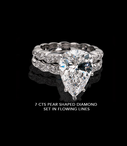 7 Carats Ring with Pear Shaped Diamond Set In Flowing Lines